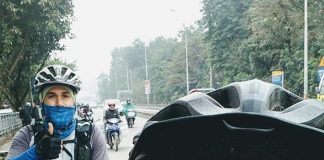 Riding a bicycle in the crazy Hanoi