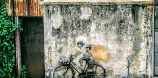 Street art George Town Malaysia Little Childrel on a Bicycle